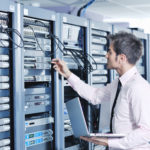 IT Recycling, laptop recycling, server recycling, image showing a man checking server